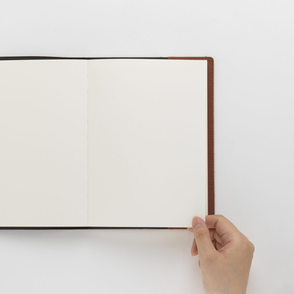 Photo of Leather Sketchbook being opened to a blank page