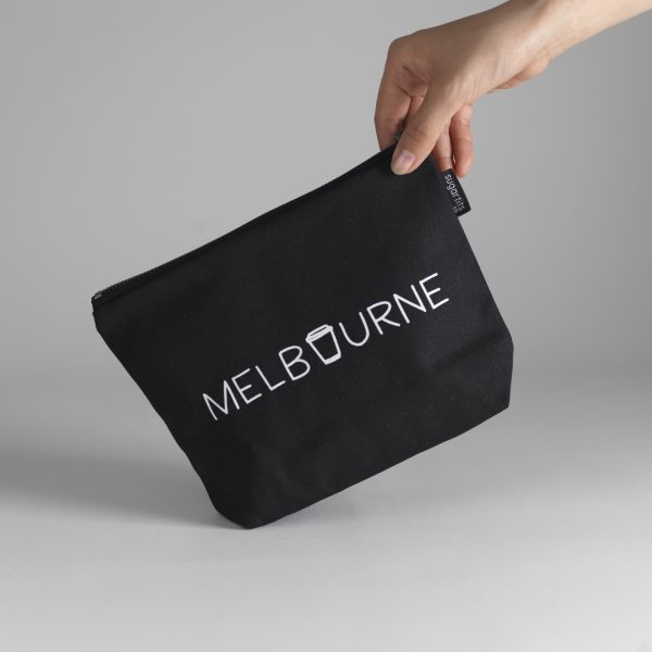 Photo of black canvas zip clutch with 'Melbourne' written on it